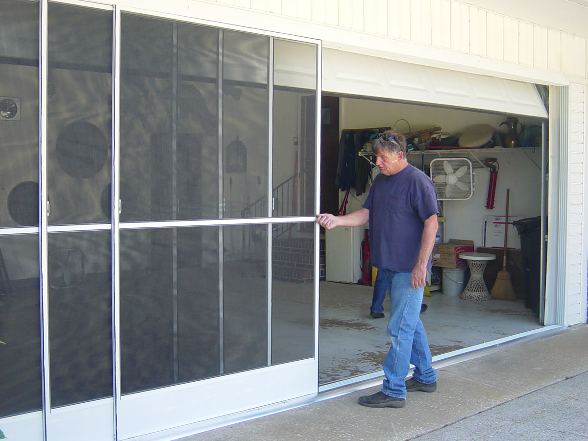 Sliding garage door screens from killian 39 s of palm coast fl for Garage screen door rollers
